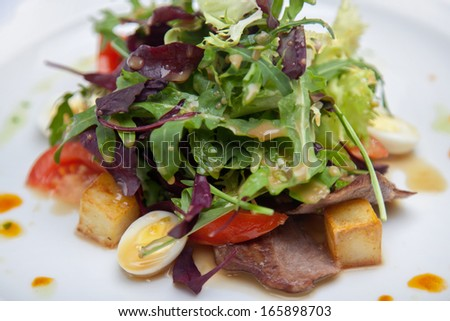 Fresh salad with herbs and tomatoes