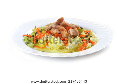 Fresh salad with lettuce, carrot and meat on dish