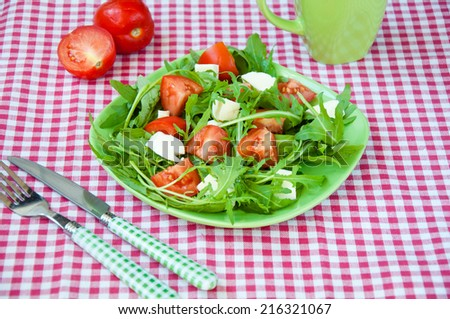 fresh salad with mozzarella, ruccola and tomatoes