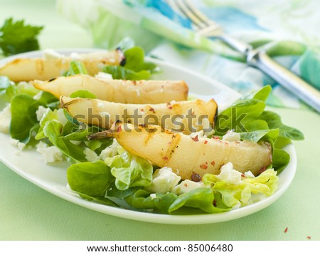 Fresh salad with pear and goat cheese. Selective focus