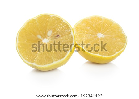 Fresh sliced lemon on white background