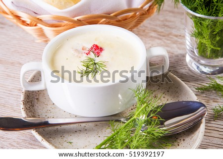 fresh soup cream with caviar and green dill in restaurant