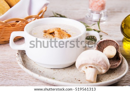 fresh soup cream with chicken and mushroom in restaurant