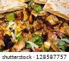 Fresh Southwestern Style Salad with Cheese Quesadilla - stock photo