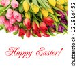 fresh spring flowers with water drops. bouquet of multicolor tulips over white background with sample text Happy Easter! - stock photo