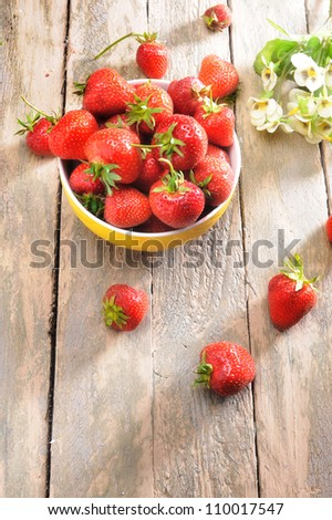 fresh strawberries on old wooden table