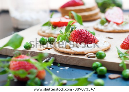 Fresh Summer Snack Sandwiches Cottage Cheese Strawberry Seeds Peas Almond Flakes Summer Fruits Vegetables Crackling Cookies on Chopping Board