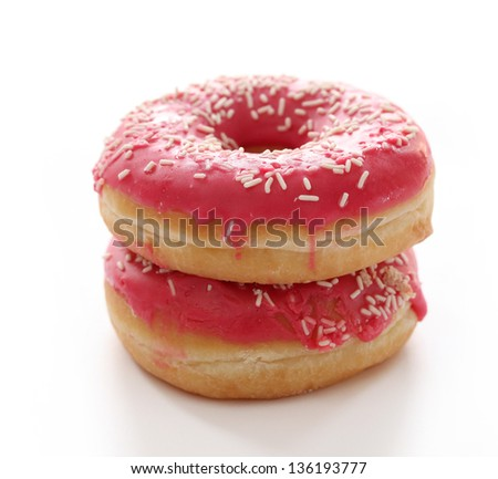 Fresh tasty donuts with glaze on a white table