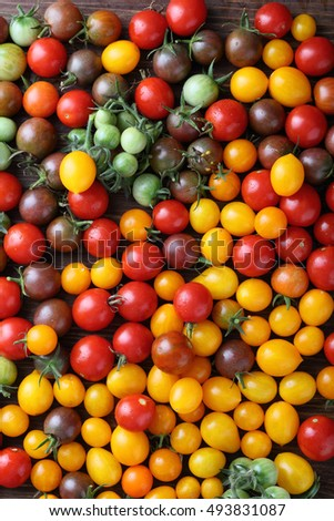 Fresh tomatoes on wood, food above