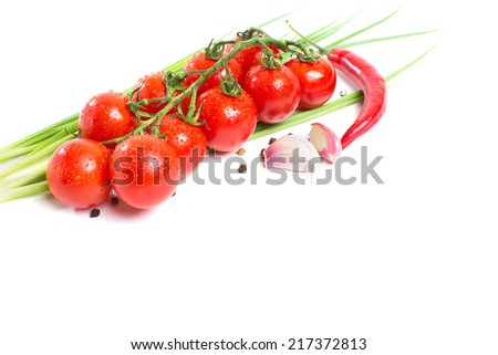 fresh tomatoes with pepper and garlic isolated on white background