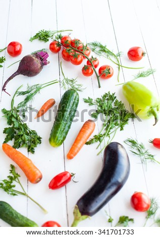 Fresh vegetables on white table, selective focus on tomato cherry