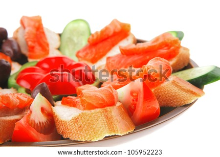 fresh vegetables with salmon on dark dish