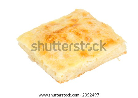 Freshly baked  piece of cheese pie isolated on a white background
