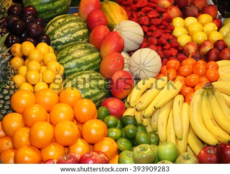 Freshly harvested collection of organic fruits as background