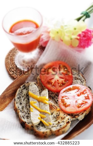 freshness tomato and sausage open sandwich with vegetable juice