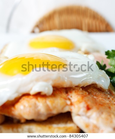 Fried eggs with toast and chicken. American breakfast