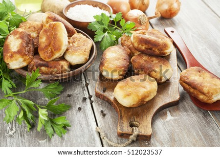 Fried pastry with potato on the table