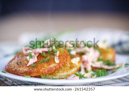 fried potato pancakes with sausage and cheese