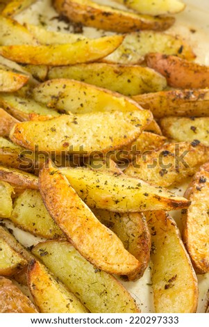 Fried potato wedges with herbs.