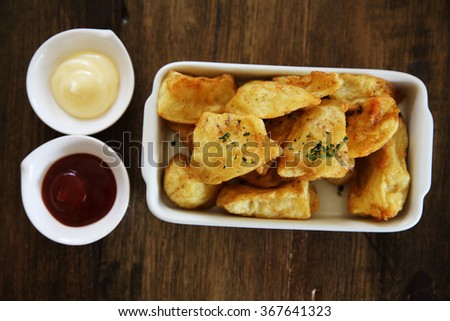 fried potatoes on wood background