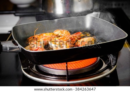 fried shrimp in pan for cooking
