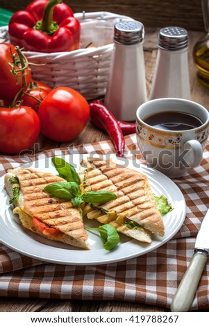 Fried toast sandwich with cheese, lettuce and tomatoes. Selective focus.