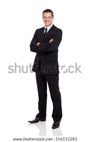 friendly business man in a suit with arms folded isolated on white