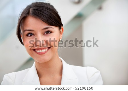 Friendly business woman portrait smiling in her office