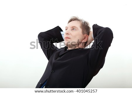 Friendly businessman looking up. Business man in Suit thinking or dreaming on White Background
