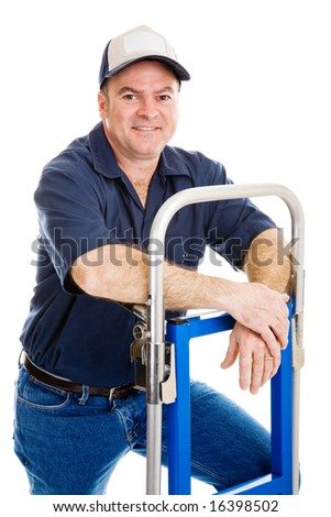 Friendly, casual delivery person or mover relaxing on his hand truck.  Isolated on white.