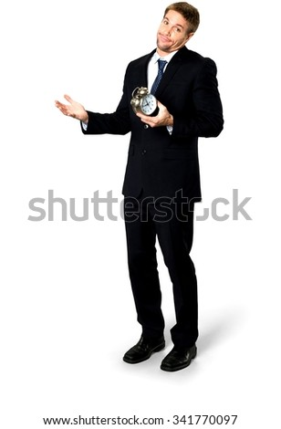 Friendly Caucasian man with short medium blond hair in business formal outfit holding alarm clock - Isolated