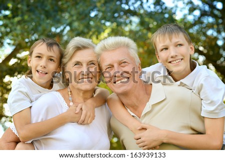 Friendly family walking in the park in summer together