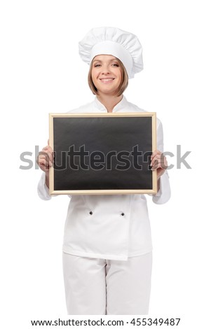 friendly female chef, cook or baker holding blackboard isolated on white background. advertisement or menu blank board. your text here