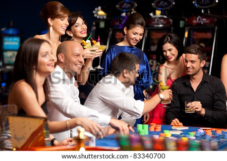 friends drinking and celebrating a gambling night