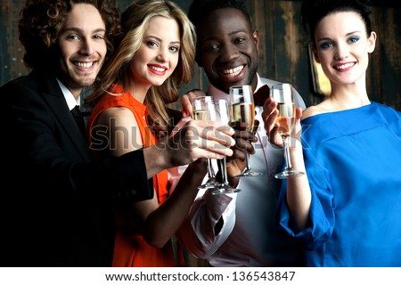 Friends enjoying champagne or wine in a party, great bonding.