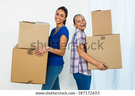 Friends holding boxes to move out