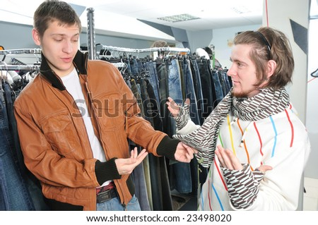 friends in wear shop doing choice