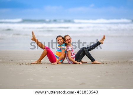 Friends seating at the beach