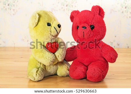 Friendship among toys, yellow bear and red bear
