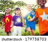 Friendship: Diverse Children Playing Super Heroes in Park - stock photo