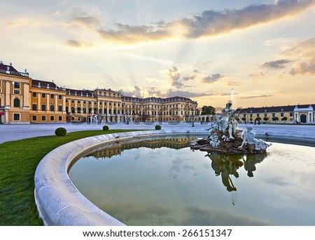 Front of the Schoenbrunn Palace in Vienna at sunset - Austria. It is a former imperial summer residence and one of the most important cultural monuments and major tourist attractions in the country.