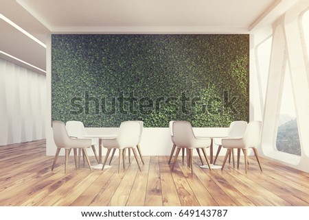 front view of an office cafe interior with a large grass wall panoramic windows with - Large Cafe Interior
