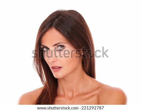 Front view portrait of pretty young woman for beauty headshot looking at camera on isolated studio