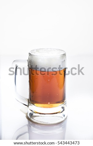 Frosty glass of  German dark beer on a white background.