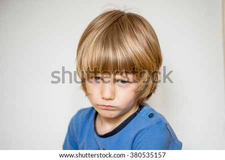Frowning unhappy child