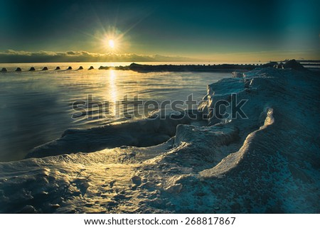 Frozen Ice reflecting sunlight on Lake Michigan in Chicago