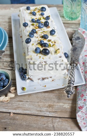Fruit - blueberries - hang dessert with cream on wooden table - Blueberry Cake for holidays