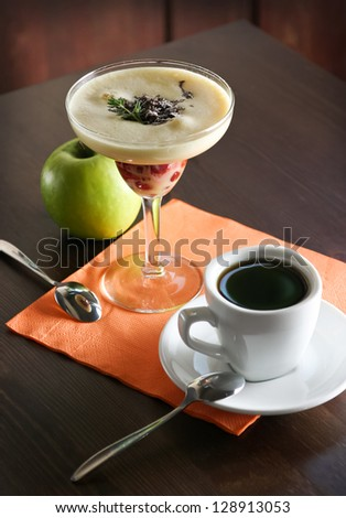 Fruit dessert and cup of coffee