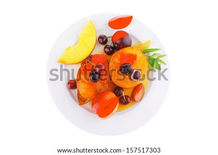 fruit ice cream with fruits on big white plate