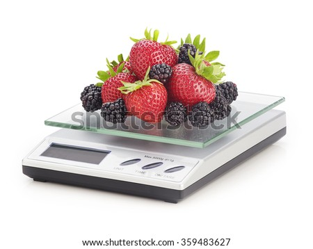 fruit on a kitchen scale